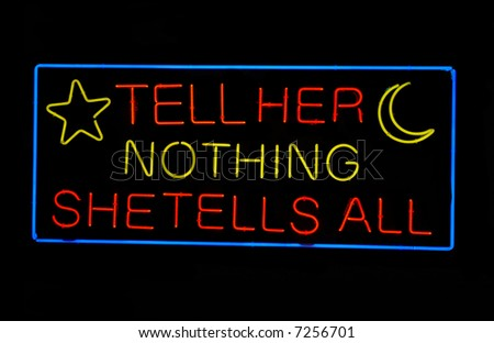 """Psychic's """"Tell Her Nothing - She Tells All"""" neon sign - stock photo"""