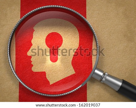 Psychological Concept. Magnifying Glass with Icon of Profile of Head with a Keyhole on Old Paper with Red Vertical Line Background. - stock photo