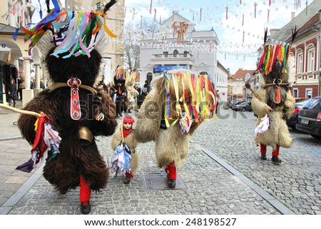 PTUJ, SLOVENIA - MARCH 1: Kurent is Slovene old traditional carnival mask with bells and dressed in fur. They chasing away the winter and calling spring. Ptuj, Slovenia March 1, 2014. - stock photo