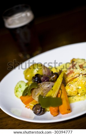 Pub food with beer in the background. - stock photo