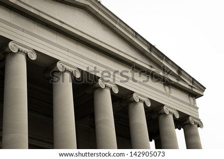 Public Building with Stone Pillars and White Background - stock photo