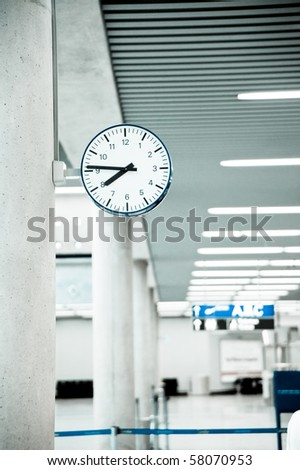Public Clock In Airport With Copyspace - stock photo