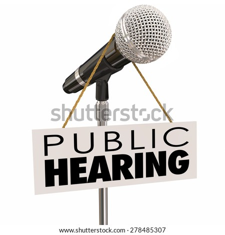 Public Hearing words on sign around a microphone to illustrate feedback, input, opinion or information sharing during a government or association meeting - stock photo