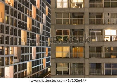 Public housing high-rise apartments in Tokyo city at night - stock photo
