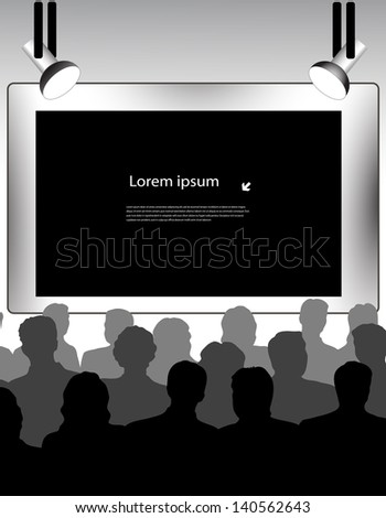 public in a hall in front of the screen - stock photo
