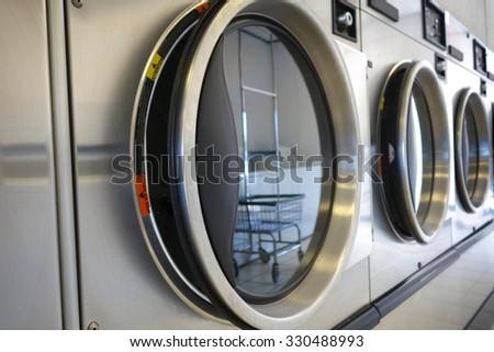 public laundromat washers                               - stock photo