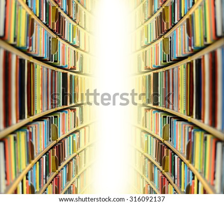 Public library bookshelf, into bright light - stock photo