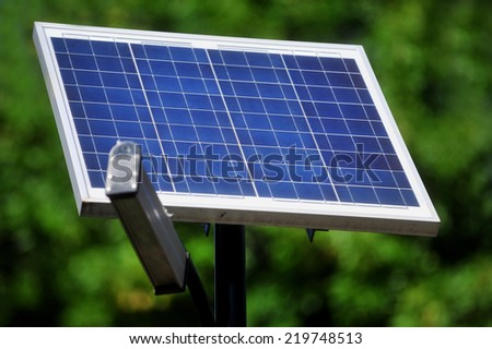 Public lighting pole with photovoltaic panel - stock photo