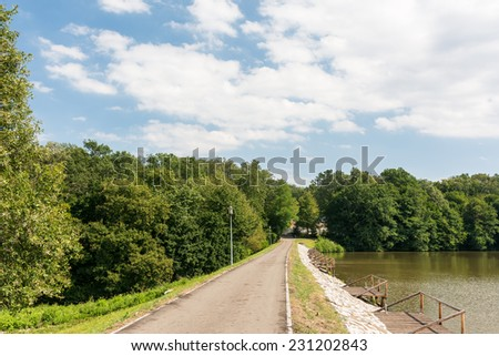 Public Park Alley Near Lake - stock photo
