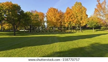 Public park panorama in Autumn colors Gresham OR. - stock photo