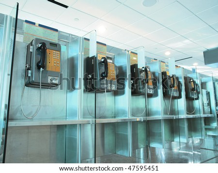 Public phone in the airport - stock photo