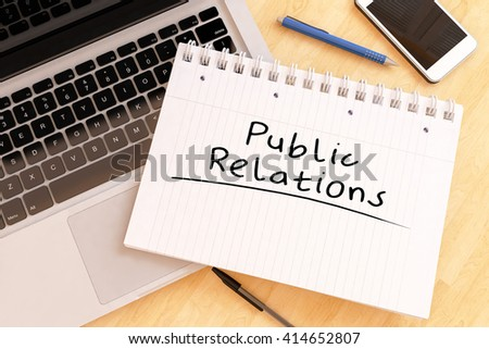 Public Relations - handwritten text in a notebook on a desk - 3d render illustration. - stock photo