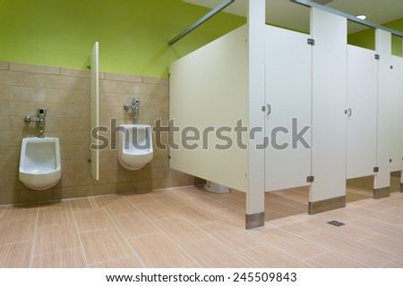 Public restroom with urinals  - stock photo