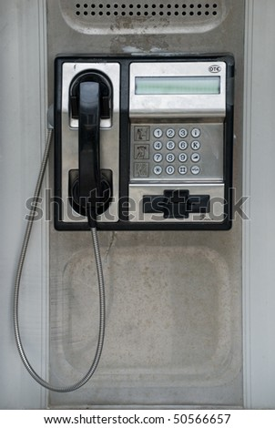 Public telephone. - stock photo
