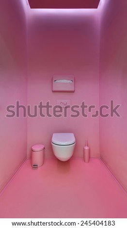 Public toilet in a modern loft style. Minimalism, toilet, brush, trash. The walls are painted in bright pink color. - stock photo