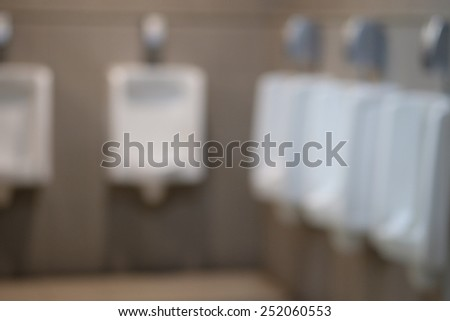 Public toilet men blur - stock photo