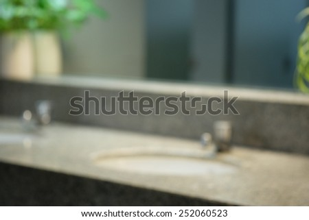 Public toilet mirror blur - stock photo