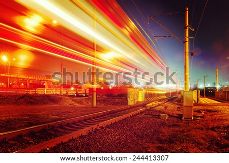 public transport metropolis, traffic and blurry lights train at night, Moscow, Russia - stock photo