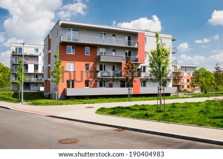 Public view of newly built block of flats in the green park - stock photo