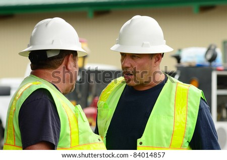Public works supervisors at a excavation hole to repair a 12 inch water main failure on Harvard Ave in Roseburg OR - stock photo