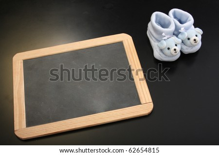 publicity board with space to put your baby name and blue clothes - stock photo