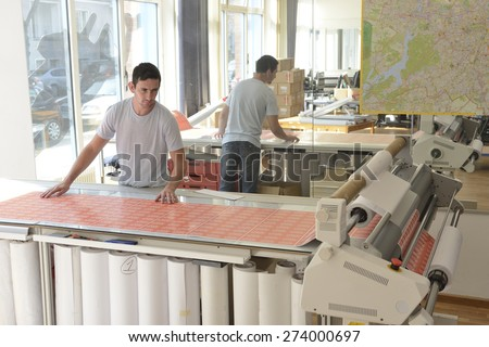 Publisher owner work on his printer creative business. - stock photo