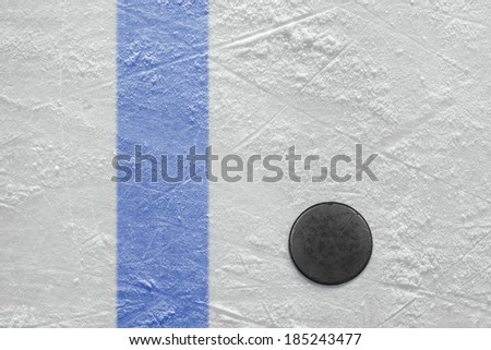 Puck lying on a hockey rink. Texture, background - stock photo