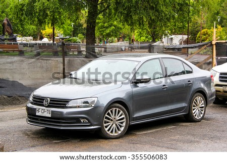 PUCON, CHILE - NOVEMBER 20, 2015:Motor car Volkswagen Vento at the town street. - stock photo