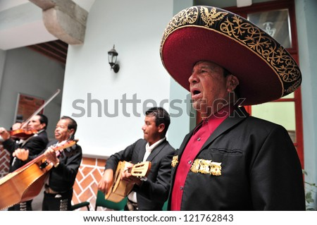 PUEBLA - FEB 25 :Mariachi band play mexican music on February 25 2010 in Puebla, Mexico. It's Mexican musical tradition that dates back to the 19th century - stock photo