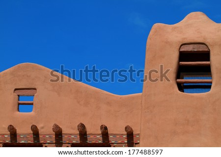 Pueblo-revival style helps make Santa Fe a popular tourist destination - stock photo