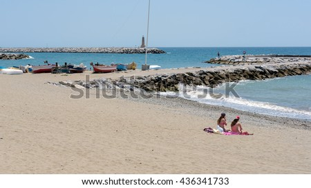 PUERTO BANUS ANDALUCIA/SPAIN - MAY 26 : People Sunbathing on the Beach at Puerto Banus Spain on May 26, 2016. unidentified people - stock photo