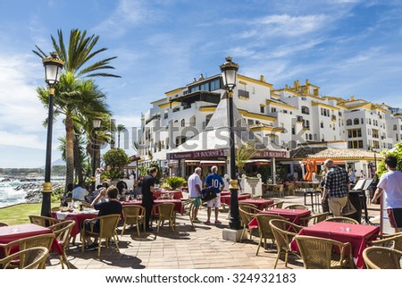 Puerto Banus, Spain - August 15, 2015: Bar with customers where you can drink watching the sea  in Puerto Banus, Marbella. - stock photo