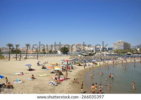 PUERTO BANUS, SPAIN - AUGUST 22, 2011: Beach in the Puerto Banus (Spain) luxury resort on August 22, 2011 - stock photo