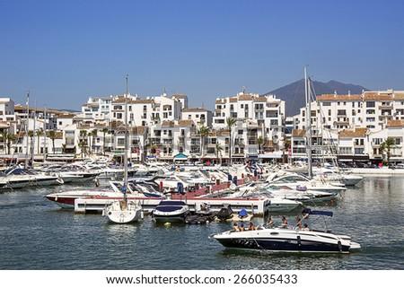 PUERTO BANUS, SPAIN - AUGUST 22, 2011: Marina in summer Puerto Banus in Spanish resort on August 22, 2011 - stock photo