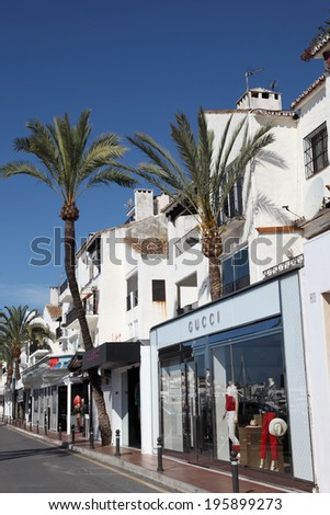 PUERTO BANUS, SPAIN - MAY 22: Shopping street at the luxury marina. May 22nd 2012 in Marbella, Costa del Sol, Andalusia, Spain - stock photo