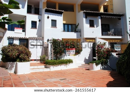 PUERTO CABOPINO, SPAIN - JUNE 7, 2009 - For sale signs on apartments, Puerto Cabopino, Costa del Sol, Malaga Province, Andalusia, Spain, Western Europe, June 7, 2009. - stock photo