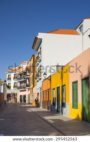 PUERTO DE LA CRUZ, TENERIFE, CANARY ISLANDS - JANUARY 11, 2014: Beautiful colorful buildings in the old town of Puerto De La Cruz. One of the most popular touristic towns, Canary islands, Spain - stock photo