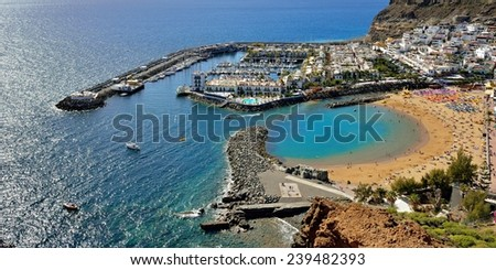 PUERTO DE MOGAN, SPAIN - FEB 19, 2014: View from above on Puerto de  Mogan, Gran Canaria. It is preferable resort of island with public beach, shopping facilities and restaurants. - stock photo