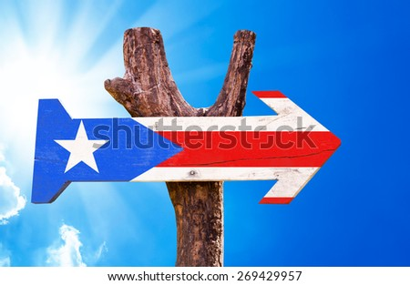 Puerto Rico Flag wooden sign with sky background - stock photo