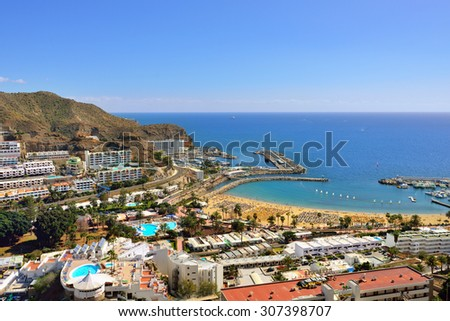 PUERTO RICO, SPAIN - FEB 19, 2014: View on of Puerto Rico resorts, Gran Canaria. It is of main resort of island with public beach and restaurants.The most popular tourist destination all the year. - stock photo