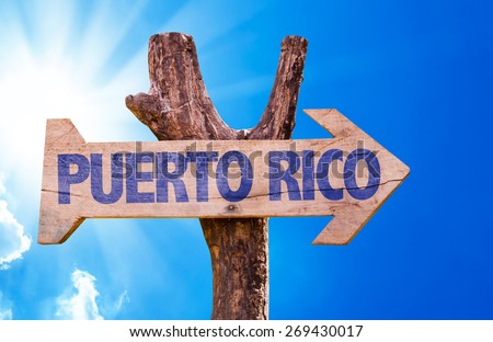 Puerto Rico wooden sign with sky background - stock photo