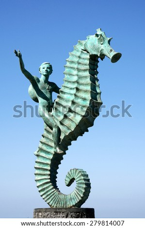 Puerto Vallarta, Mexico February 17, 2014: The Boy and Seahorse sculpture stands under a beautiful sunny sky along the Malecon boardwalk in Puerto Vallarta, Mexico on February 17, 2014. - stock photo