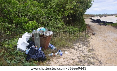 PUERTO VILLAMIL, ECUADOR - NOVEMBER 19, 2015:Trasch full of rubbish on the beach on 19 November 2015 in Puerto Villamil, Ecuador.The beaches of the Galapagos islands are frequented not only by tourist - stock photo