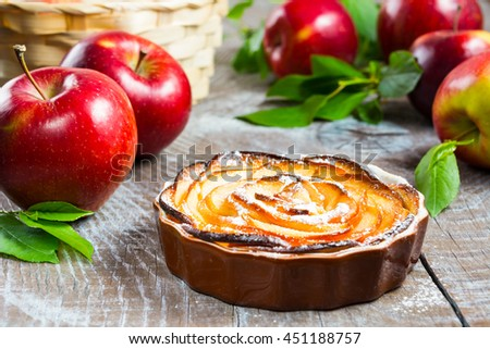 Puff apple shaped roses pie. Homemade sweet apple dessert pie. Homemade apple rose pastry.  - stock photo