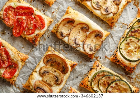 Puff pastry appetizers with vegetables; mushrooms, tomatoes and zucchini - stock photo