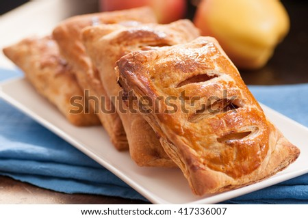 puff pastry apple pastry turnovers for dessert - stock photo