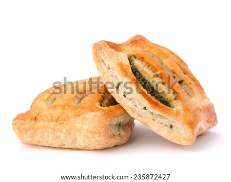 Puff pastry bun isolated on white background. Healthy patty with spinach. - stock photo