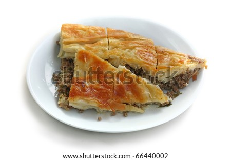 Puff pie stuffed with meat on a white background - stock photo