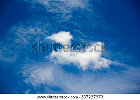 Puffy clouds blue wide dreamy sky background and soft relax feeling - stock photo