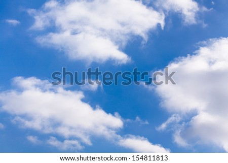 puffy clouds sky shiny atmosphere - stock photo